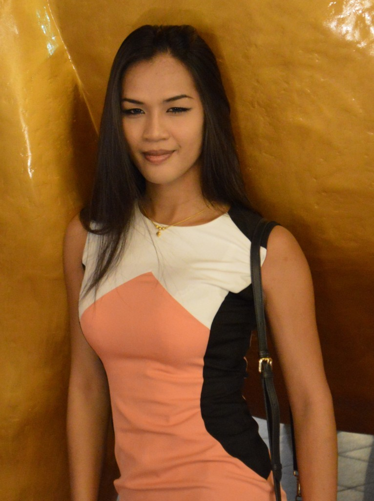 Annie wearing orange and white dress David Bonnie Bangkok Thailand davidbonnie.com