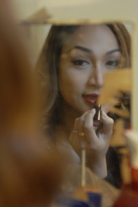 Thai Ladyboy applies lipstick David Bonnie Bangkok Thailand davidbonnie.com