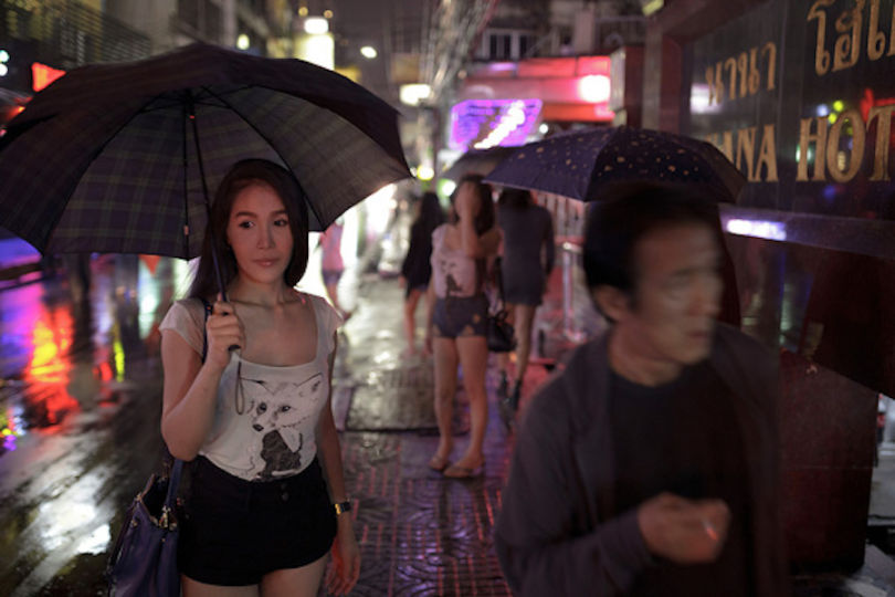 Thai Woman holding an Umbrella in Rain David Bonnie Bangkok Thailand davidbonnie.com